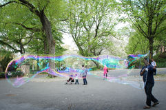 Man making huge soap bubbles in Central Park in New York Royalty Free Stock Photo