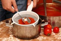 Man making ketchup Stock Photo