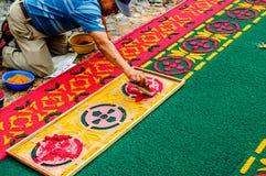 Man making Lent processional carpet, Antigua, Guatemala. Antigua, Guatemala - Mar 1, 2015: Man making Lent processional carpet in path of religious procession Stock Photo