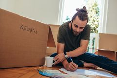 Man making a list of articles for packing stock photography