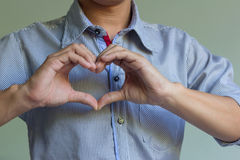 Man making a love sign Stock Photography