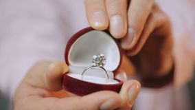 Man making marriage proposal, close-up of hands showing beautiful silver ring. Stock footage stock footage