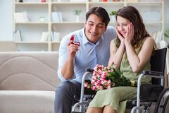 The man making marriage proposal to disabled woman on wheelchair Royalty Free Stock Photo