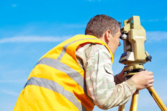 Man making measuring with theodolite Royalty Free Stock Image