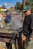 Man Making Molasses Stock Photo