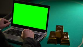 Man making money in internet, gold bars lying near, investments in reliable bank. Stock footage stock footage