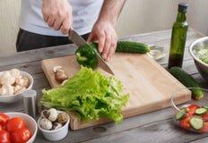 Man making morning breakfast of salad Stock Photos