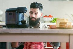 Man making morning espresso with coffee machine Royalty Free Stock Photography