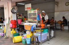 A man making noodles at noodle stall on the street in Penang, Ma Stock Image