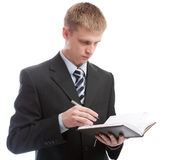 Man making notes in diary Stock Photos