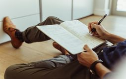 Free Man Making Notes In His Diary Royalty Free Stock Photography - 116946357