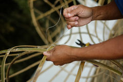 Man making object from bamboo by hand knitting Royalty Free Stock Photography