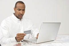 Man Making Online Transaction Stock Images