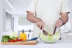Man making organic salad Royalty Free Stock Photo