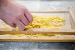 Man making pasta alla chitarra Stock Photo