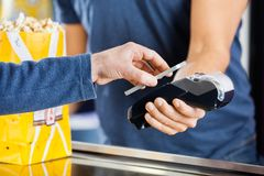 Man Making Payment Through NFC Technology At Stock Images