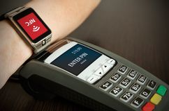 Man making payment through smartwatch via NFC technology Stock Photo