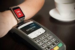 Man making payment through smartwatch via NFC technology. Man making payment through smartwatch via NFC contactless technology Stock Photography