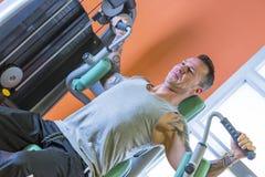 Man making pec deck fly - workout routine Stock Photo