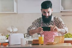 Man making photo with camera phone of breakfast Royalty Free Stock Photography