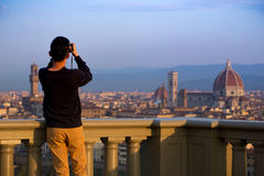 Man making a photo shoot of Florence with the smartphone Royalty Free Stock Image