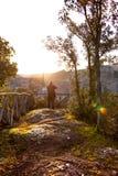 Tuff city of Sorano. Man making a photo shoot of old city sorano at dawn, italy royalty free stock photo