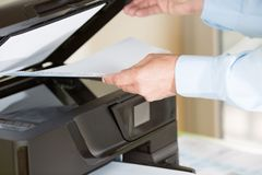 Man making a photocopy Stock Photography