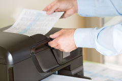 Man making a photocopy Stock Images