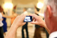Man making a picture during the reception party Royalty Free Stock Image