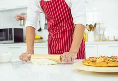 A man is making pizza stock images
