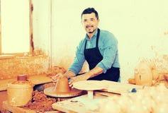 Man making pot. Happy senior man making pot using pottery wheel in studio royalty free stock photography
