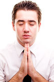 Man making a prayer Stock Image