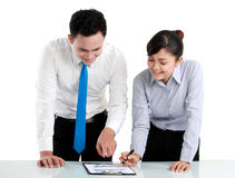 Man making a presentation and discussing bar chart. Business men and women discussing bar chart Royalty Free Stock Photo
