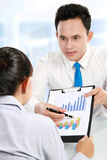Man making a presentation and discussing bar chart Stock Image
