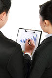 Man making a presentation and discussing bar chart. Portrait of Business men and women discussing bar chart Stock Image