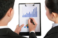Man making a presentation and discussing bar chart. Portrait of Business men and women discussing bar chart Stock Images