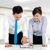 Man making a presentation and discussion. Man and women business worker making a presentation on meeting in the office Stock Photo