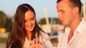 Man making a proposal on one knee, giving stock footage