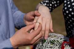 Man making proposal with the ring to his girlfriend. Put ring on hand. selective focus Royalty Free Stock Images