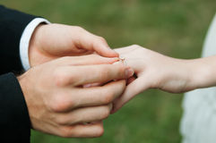 Man making proposal with the ring to his girlfriend. Put ring on Royalty Free Stock Photo