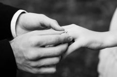 Man making proposal with the ring to his girlfriend. Put ring on Stock Photos