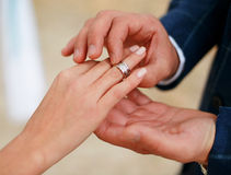 Man making proposal with the ring to his girlfriend. Put ring on hand. Royalty Free Stock Images