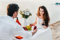 Man making propose with ring to attractive woman in romantic. Date outdoors stock photos