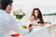 Man making propose with ring to girlfriend. In romantic date on seashore royalty free stock photos
