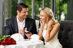Man making propose to his girlfriend stock photo