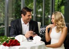 Man making propose to his girlfriend Stock Photos