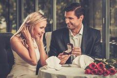 Man making propose to his girlfriend royalty free stock image