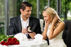 Man making propose to his girlfriend stock image