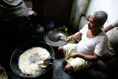 Man making puri Stock Photo