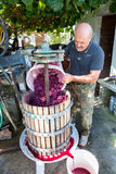 Man making red wine stock images